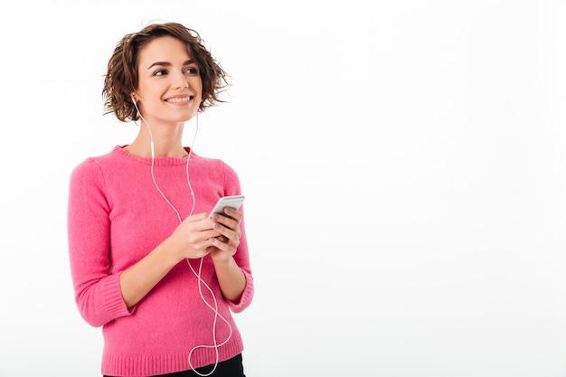 Portret Uśmiechnięta Młoda Dziewczyna Słucha Muzyka Darmowe Zdjęcia