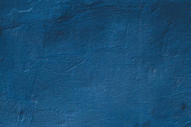Porysowana ściana Betonowa. Niebieskie Tło Grunge, Abstrakcyjny Wzór, Naturalne Malowane Tekstury Cementu, Ciemny Kamień Szablon. Premium Zdjęcia