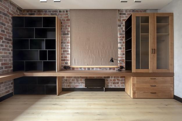 Prosta współczesna aranżacja salonu w mieszkaniu Premium Zdjęcia