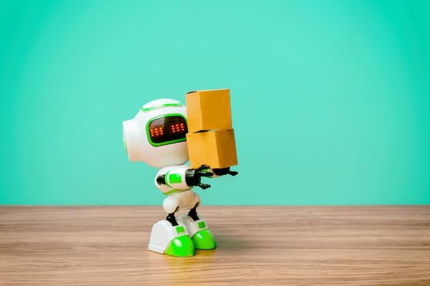 Przemysłowy robot zajmujący się produkcją pudeł lub robotów pracujących zamiast ludzi Premium Zdjęcia