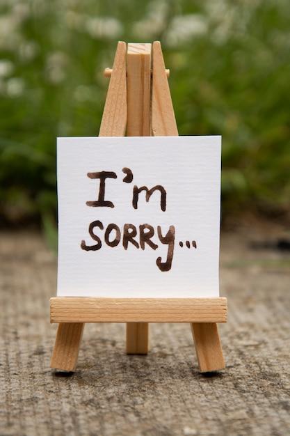 Przepraszam. Naklejka Z Przepraszającym Napisem. Mini Chalckboard. Premium Zdjęcia