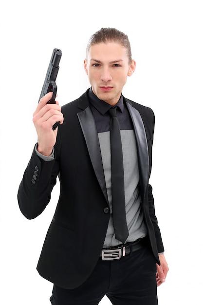 Przystojny mężczyzna z pistoletem Darmowe Zdjęcia
