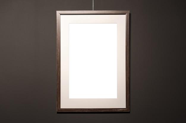 Pusta Ramka Na Czarnej ścianie Premium Zdjęcia
