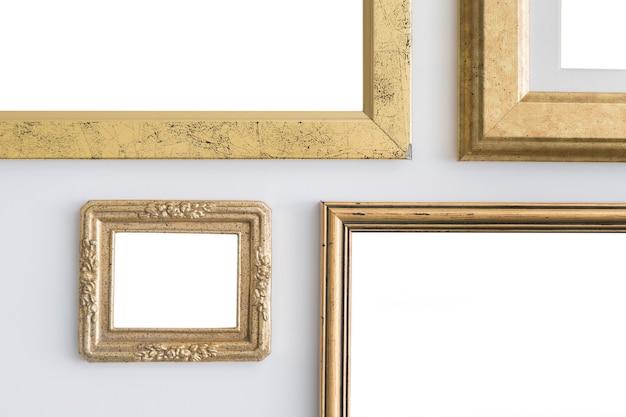 Puste Puste Złote Ramki Na Białym Tle. Premium Zdjęcia