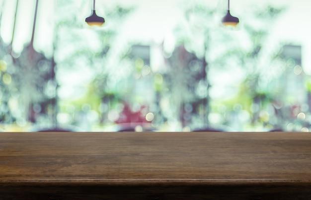 Pusty Blat Z Drewna Z Niewyraźne Café Restauracja Tło Premium Zdjęcia