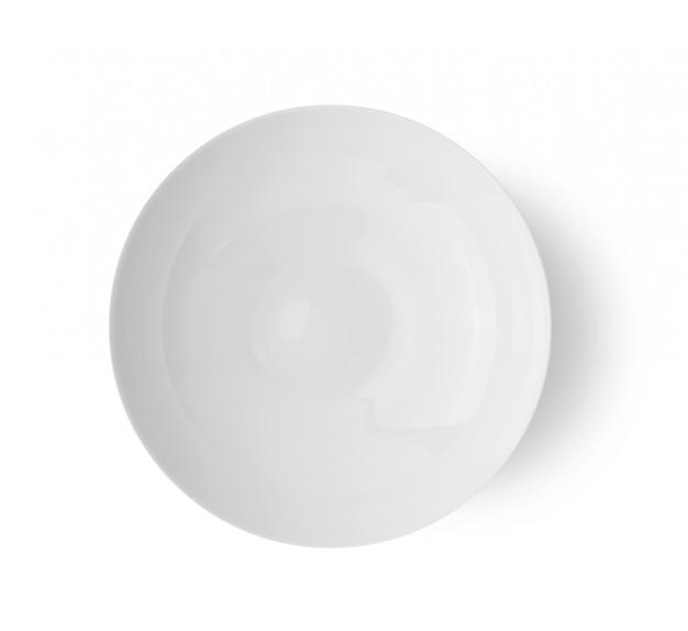 Pusty Ceramiczny Round Talerz Odizolowywający Na Białym Backgroud. Widok Z Góry Premium Zdjęcia
