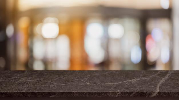 Pusty Czarny Marmurowy Kamień Blat I Niewyraźne Sklep Z Kawą I Restauracją. Premium Zdjęcia