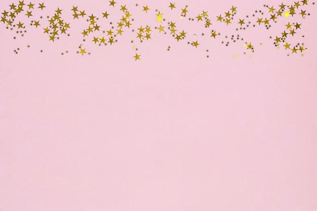 Rama Z Złotych Gwiazd Brokat Konfetti Na Różowym Tle. Premium Zdjęcia