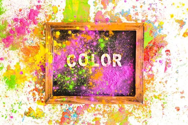 Ramka na zdjęcia z kolorowym napisem między hałdami jasnych, suchych kolorów Darmowe Zdjęcia