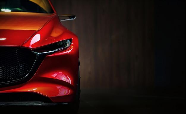 Reflektory czerwony nowoczesny samochód na czarnym tle Premium Zdjęcia