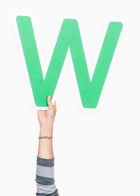 Ręka trzyma literę w znak Darmowe Zdjęcia