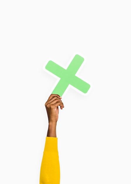 Ręka trzyma literę x znak Darmowe Zdjęcia