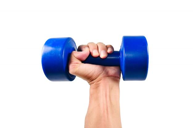 Ręka trzyma niebieski hantle do ćwiczeń Premium Zdjęcia