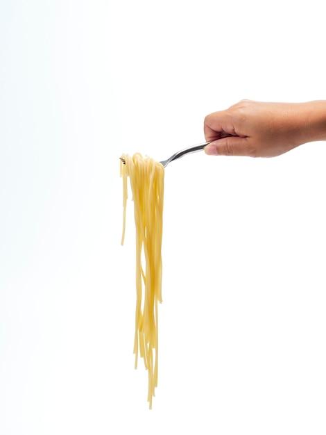 Ręka trzyma widelec uchwyt rolki spaghetti linii Premium Zdjęcia