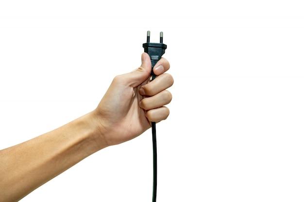 Ręka Trzyma Wtyczkę Elektryczną Izolowaną Z Białym Tłem. Premium Zdjęcia