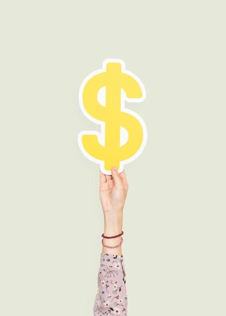 Ręka trzyma znak dolara Darmowe Zdjęcia