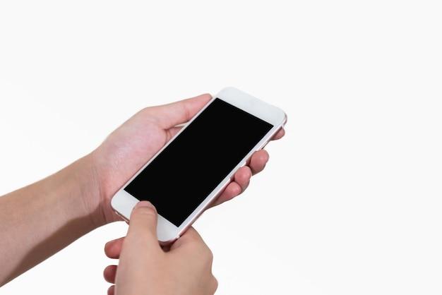 Ręki dziewczyna używa wiszącą ozdobę odosobnionego białego tło Premium Zdjęcia