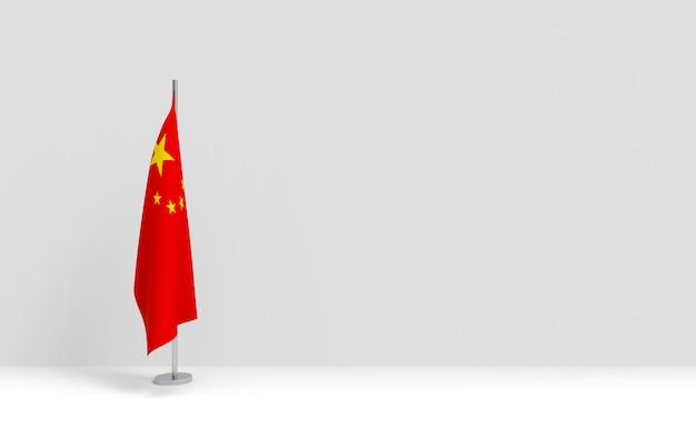 Renderowania 3d. Składane Chińskie Flagi Narodowej Podium Na Pustej Scenie Z Szarego Cementu Premium Zdjęcia