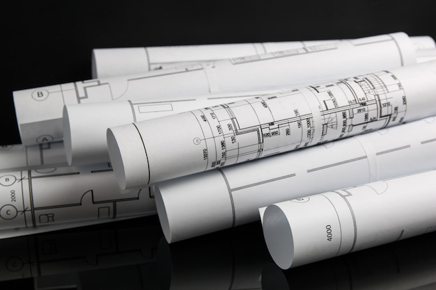 Rolkowe rysunki architektoniczne i plan. Premium Zdjęcia