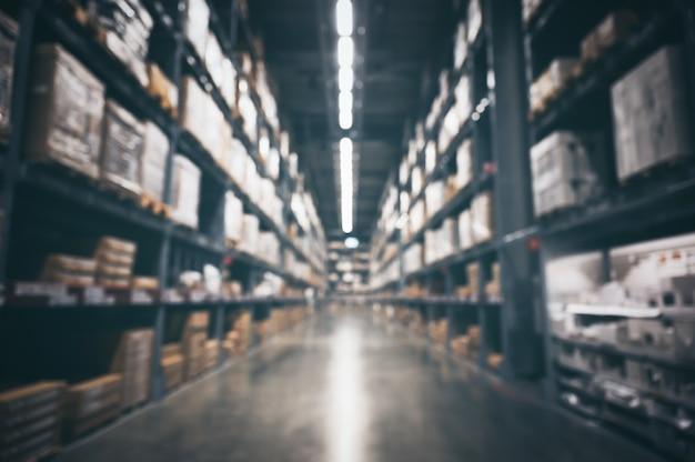 Rozmazana ściana Zapasów Magazynowych Produktów Dla Logistyki, Koncepcji Międzynarodowego Importu I Eksportu Premium Zdjęcia