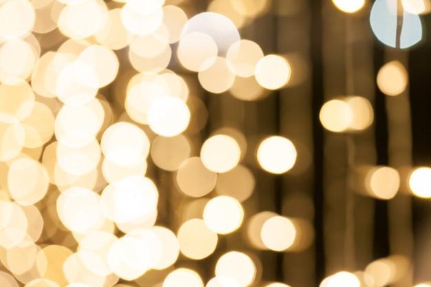 Rozmyty Tło Wiele Małe żarówek Dekoracje W Nocy Przyjęciu. Premium Zdjęcia