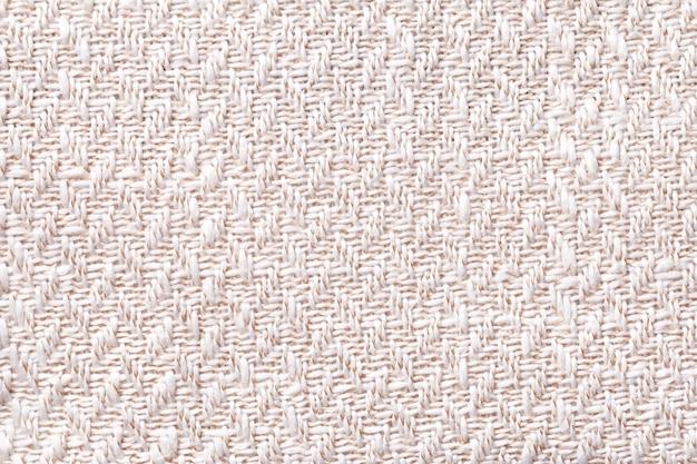 Różowa Rocznik Tkanina Z Tkanym Tekstury Zbliżeniem. Tło Białe Tekstylne Makro Premium Zdjęcia