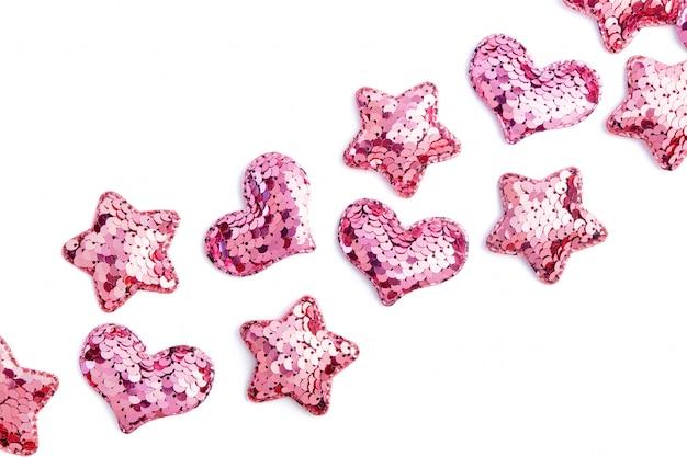 Różowe Cekiny Serca I Gwiazdy Na Białym Tle Premium Zdjęcia