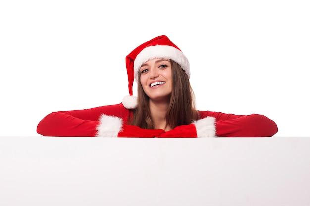 Santa Dziewczyna Opierając Się Na Pustej Desce Darmowe Zdjęcia