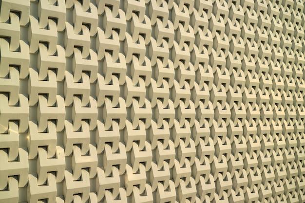 Ściana zewnętrzna nowoczesnego budynku w ciepłym świetle słonecznym Premium Zdjęcia