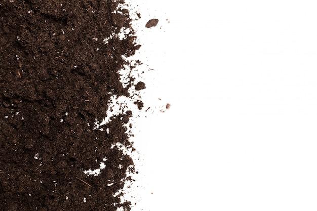 Sekcja gleby lub brud na białym tle Premium Zdjęcia
