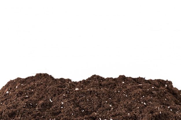 Sekcja gleby lub brudu na białym tle Premium Zdjęcia
