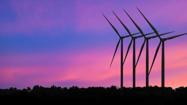 Silniki Wiatrowe Turbiny O Zachodzie Słońca, Alternatywne źródła Energii Odnawialnej Premium Zdjęcia
