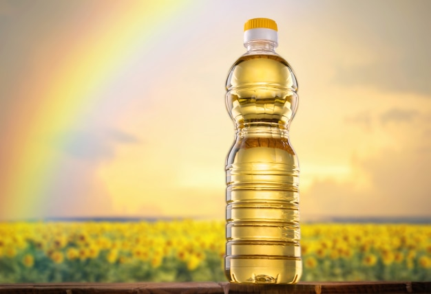 Słonecznikowy Olej Na Słoneczniki Odpowiadają Tło Premium Zdjęcia