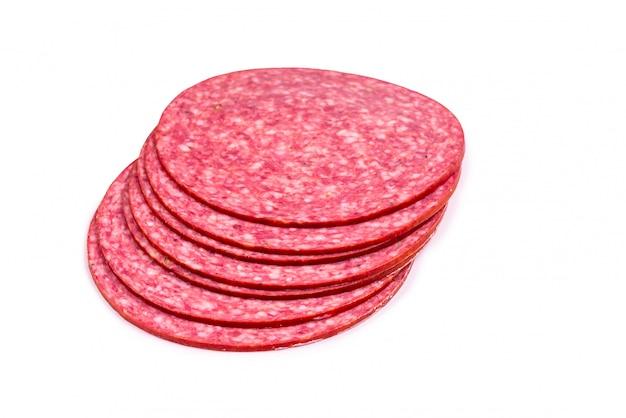 Smakowici Salami Plasterki Odizolowywający Na Bielu Premium Zdjęcia