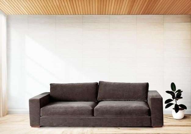 Sofa przy wyłożonej kafelkami ścianie Darmowe Zdjęcia