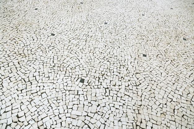 Stara Ulica Droga Utwardzona Nawierzchnia Chodnik Kamienny Chodnik Tekstura. Kostka Brukowa Granitowa Premium Zdjęcia