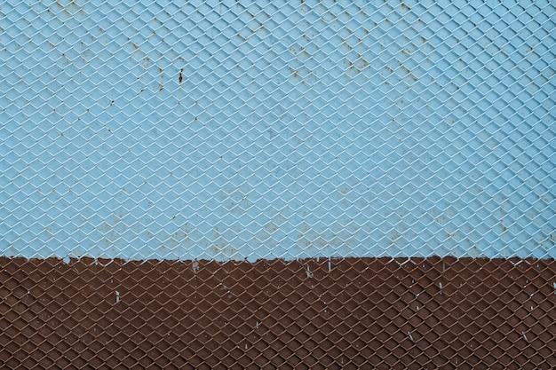 Stare żelazne Tło Siatki Bez Szwu Wzór Siatki Metalowej Niebieski I Brązowy Malowane Premium Zdjęcia