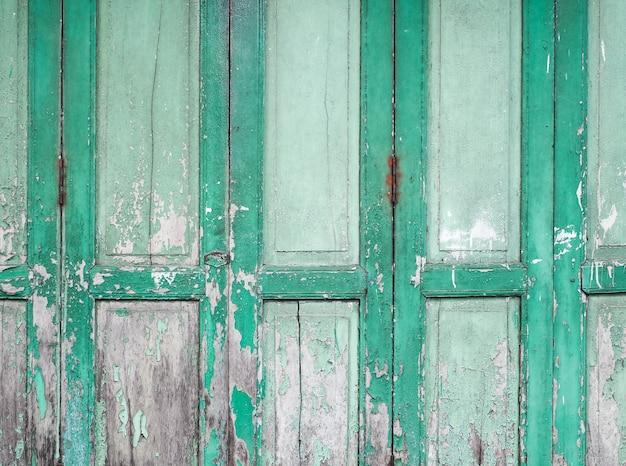 Stare Zielone Malowane Panele Drewniane Drzwi. Zielona Drewniana Podława Deska Textured I Tło. Premium Zdjęcia