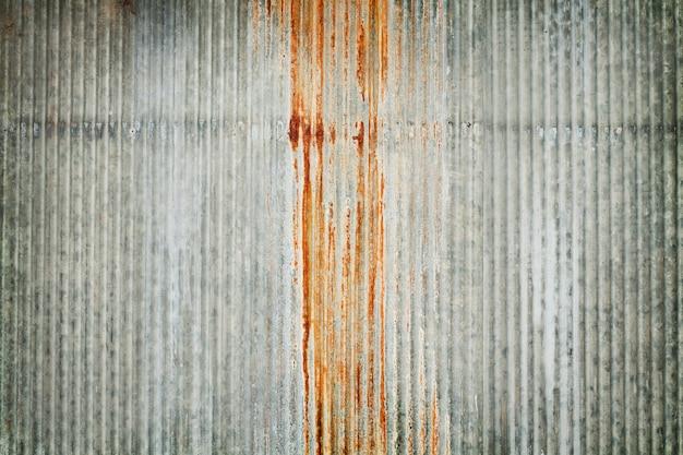 Stary cynk ściany tekstury tło, ośniedziały na galwanizującym metalu panelu prześcieradle. Premium Zdjęcia