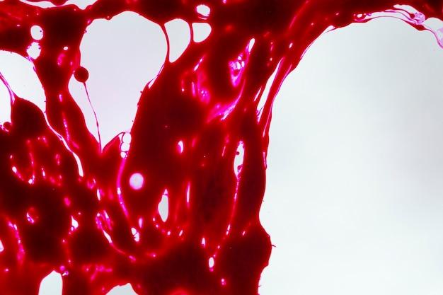 Streszczenie czerwony szlam na szarym tle Darmowe Zdjęcia