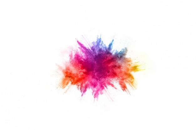 Streszczenie proszku splatted tło. eksplozja kolorowy proszek na białym tle. Premium Zdjęcia