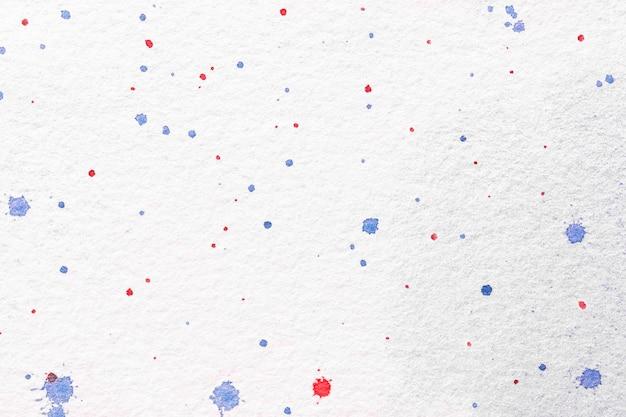 Streszczenie Sztuka Tło Białe Kolory. Akwarela Na Płótnie Z Czerwono-niebieskimi Plamami. Premium Zdjęcia