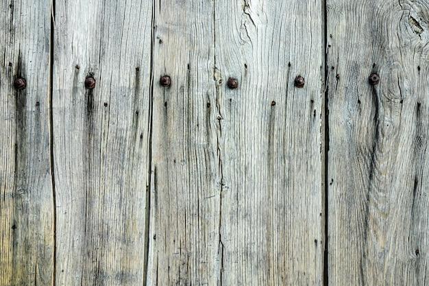 Strzał Zbliżenie Szare ściany Drewniane Z Gwoździami Na Nim Darmowe Zdjęcia