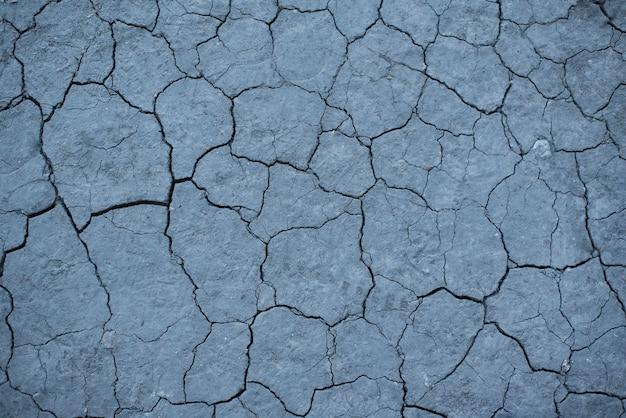 Sucha popękana szara ziemia. Premium Zdjęcia