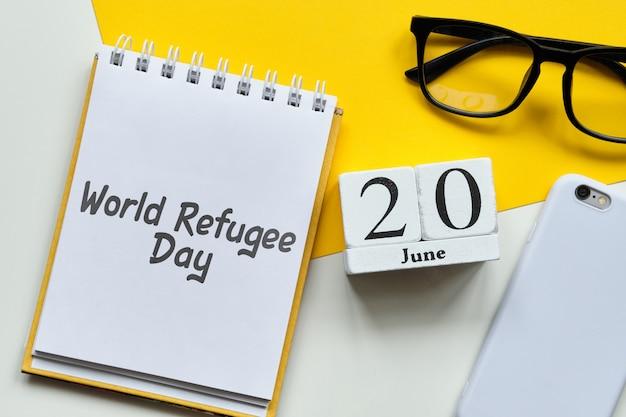 Światowy Dzień Uchodźcy 20 Czerwca Kalendarz Miesiąca Koncepcja Na Drewniane Klocki. Premium Zdjęcia