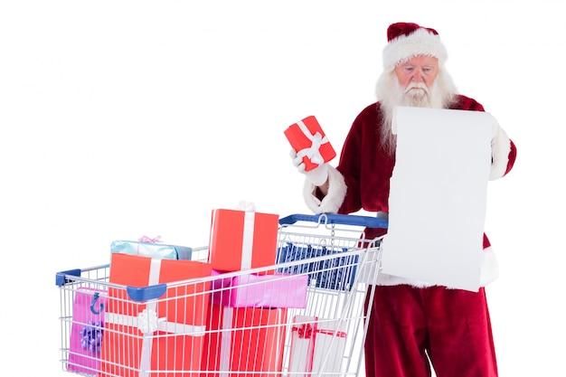 Święty Mikołaj Rozkłada Prezenty Z Koszyka Premium Zdjęcia