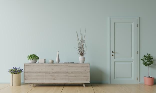 Szafka Z Rośliną I Drzwiami Przed Białą ścianą. Premium Zdjęcia