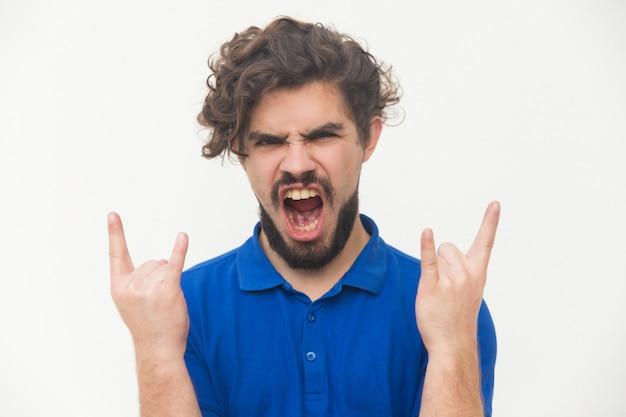 Szalony Fan Rocka I Metalu Tworzący Diabelskie Rogi Darmowe Zdjęcia