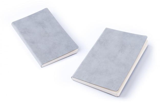 Szary rzemienny notatnik odizolowywający na białym tle Premium Zdjęcia