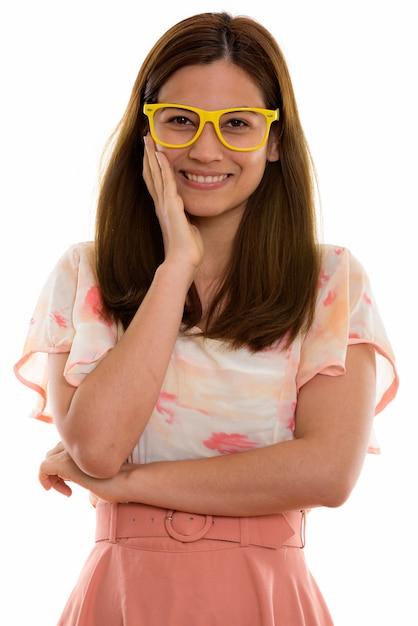 Szczęśliwa Młoda Piękna Kobieta Uśmiecha Się I Dotyka Jej Twarzy Premium Zdjęcia